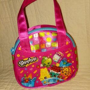 Little girl's Shopkins bag with bonus inside